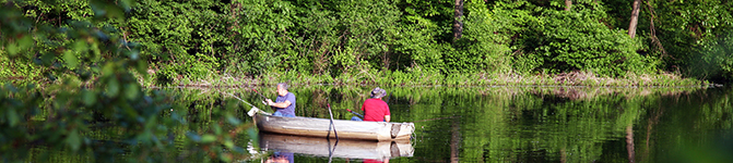 Two guys Fishing in a Lake on a Canoe
