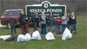 Kids taking Group photo after picking up trash at Seneca Pond